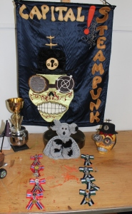 Featuring the Tea Cosy of Doom and the Winners medals. (Hand made by me)