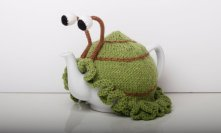 knitted snail tea cosy